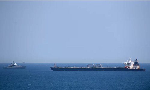 A British Royal Navy ship (L) patrols near supertanker Grace 1 suspected of carrying crude oil to Syria in violation of EU sanctions after it was detained off the coast of Gibraltar on July 4, 2019. JORGE GUERRERO—AFP/Getty Images
