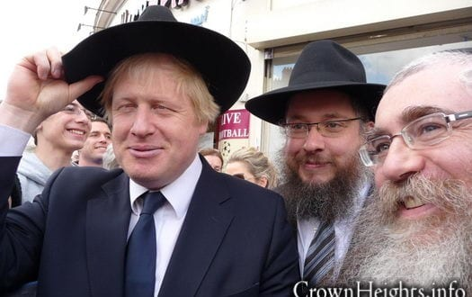 London mayor Boris Johnson, currently in the midst of his re-election campaign, appears in this photograph with Rabbis Leivi and Zalman Sudak,   Chabad Shluchim in Edgware, sporting the Lubavitcher headgear